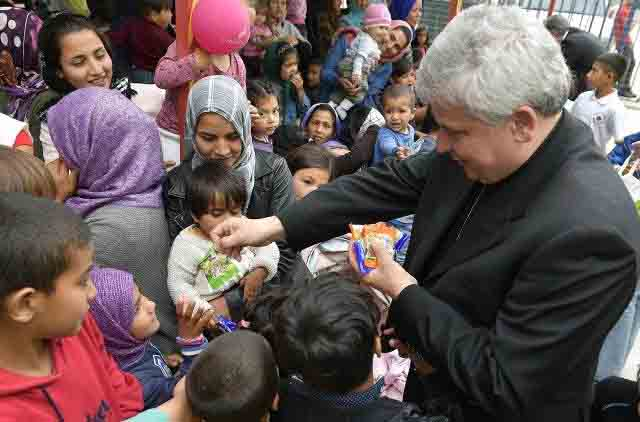 Pope welcomes another group of refugees from Lesbos accompanied by Card. Krajewski